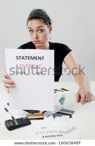Frustrated woman looking worried about overdue accounts.  - stock photo