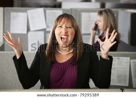 Frustrated woman office worker screaming with hands in air - stock photo