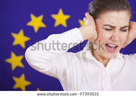 frustrated woman screaming from stress over european union flag - stock photo