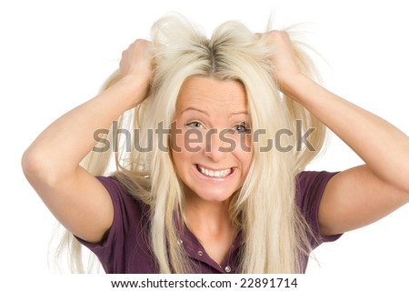 frustrated woman tearing her hairs - stock photo