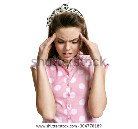 Frustrated woman with a headache / photo of young brunette woman over white background, negative emotions - stock photo