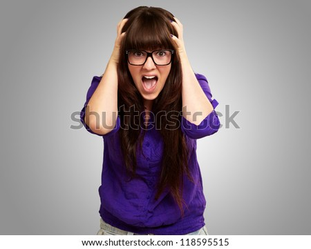 Frustrated Woman With Mouth Open Isolated On Grey Background - stock photo