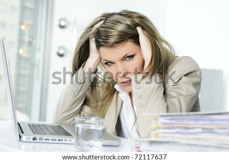 frustrated woman working on computer - stock photo