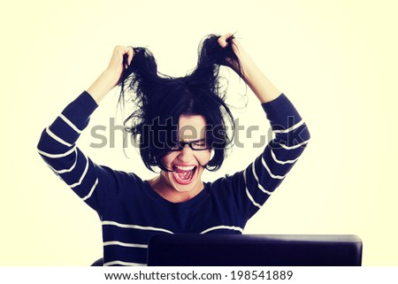 Frustrated woman working on laptop. - stock photo