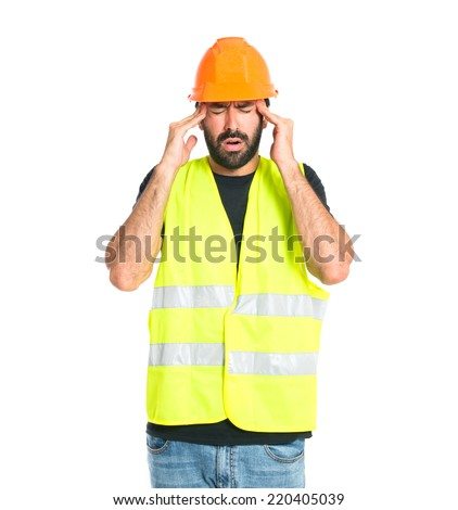 frustrated workman over isolated white background - stock photo