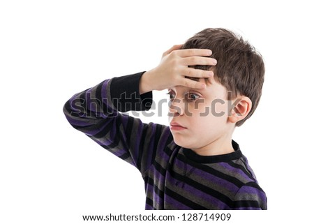 Frustrated 9 year old boy with hand on head isolated on a white background - stock photo