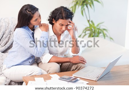Frustrated young couple underestimated their expenses - stock photo