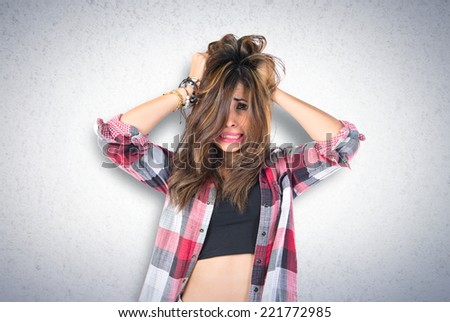 frustrated young girl over grey background - stock photo