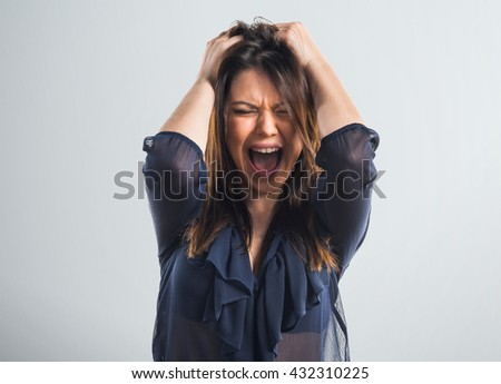 Frustrated young girl over grey background