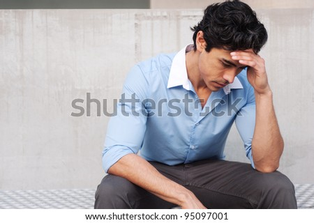 Frustrated young, handsome latino businessman