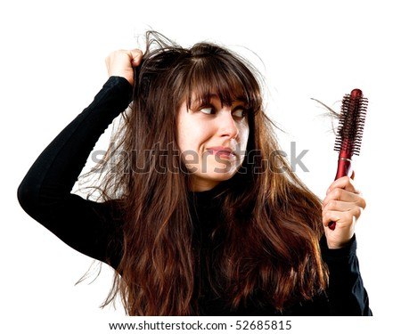 Frustrated young woman having a bad hair day - stock photo