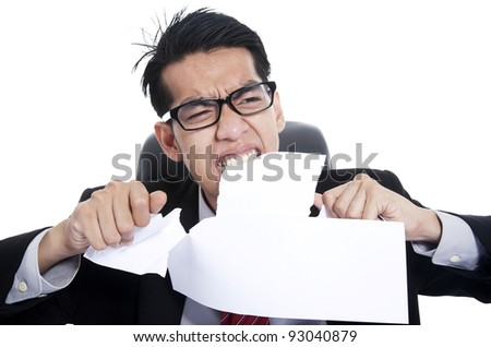 Frustration businessman tearing documents with his hands and teeth - stock photo