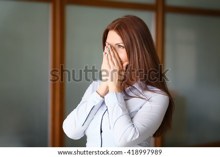 Frustration. Frustrated and stressed young businesswoman in suit. Beautiful young mixed race asian / caucasian woman - stock photo