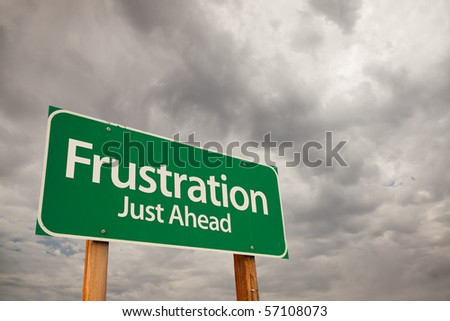 Frustration Just Ahead Green Road Sign with Dramatic Storm Clouds and Sky. - stock photo