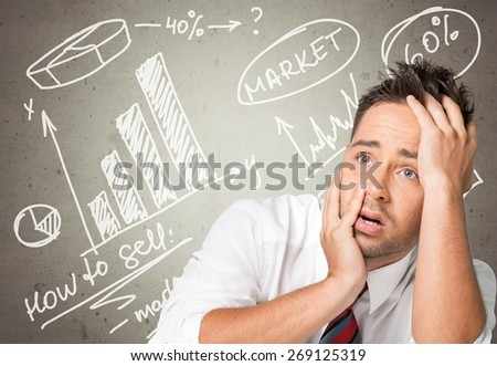 Frustration. Young man pulling funny face on white background - stock photo