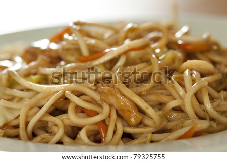 Fry noodles with chicken meat and vegetable - stock photo