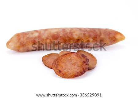 Fry sliced sausage on white background