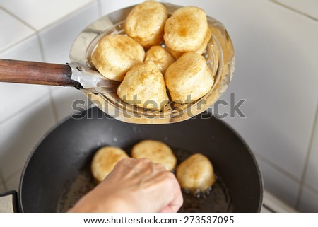 Frying fish cake in the kitchen - stock photo