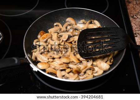 Frying mushrooms - stock photo