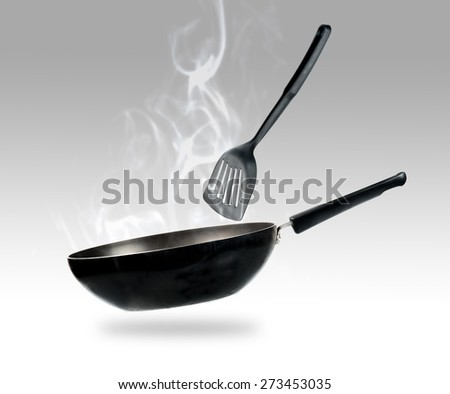 frying pan and smokw in kitchen