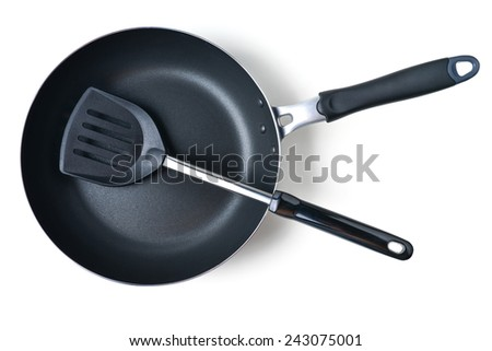 frying pan and spatula on white background - stock photo