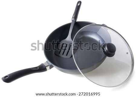 frying pan, glass lid and plastic paddle isolated on white background - stock photo