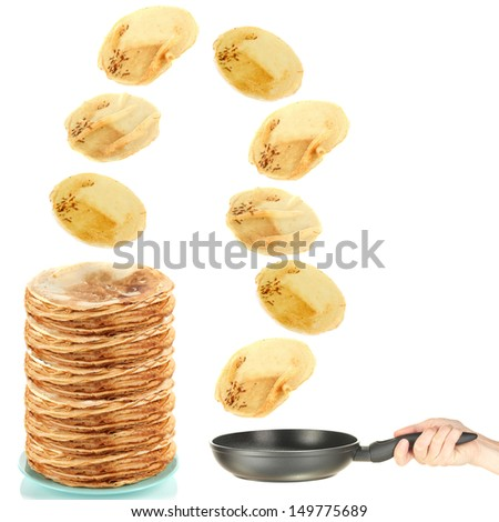 Frying pan with flying pancakes - stock photo