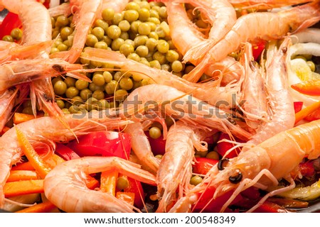 frying pan with shrimps and vegetables - stock photo