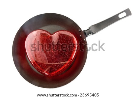 Frying pan with the big red heart. Isolated