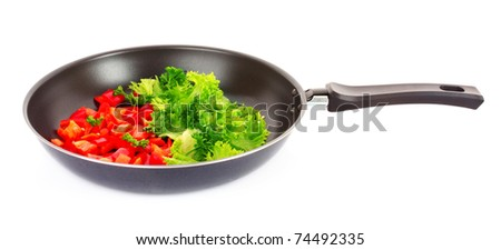 frying pan with vegetables  on white - stock photo