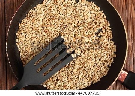 Frying sunflower seeds - stock photo