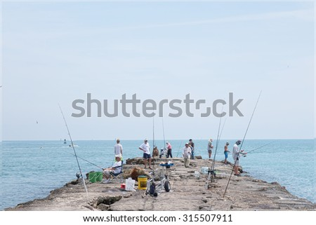 Ft, Pierce, FLORIDA - March 22, 2015: View of the pier in the Ft. Pierce inlet where people can enjoy sport fishing at their leisure  - stock photo
