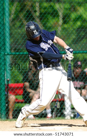 FT. WASHINGTON, PA - APRIL 23: Malvern Prep infielder Chase Gunther swings at a pitch in a game against rival Germantown Academy on April 23, 2010 in Ft. Washington, PA. - stock photo