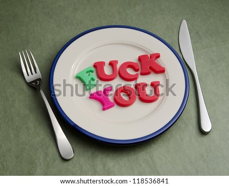 fuck you spelled out on dinner plate - stock photo
