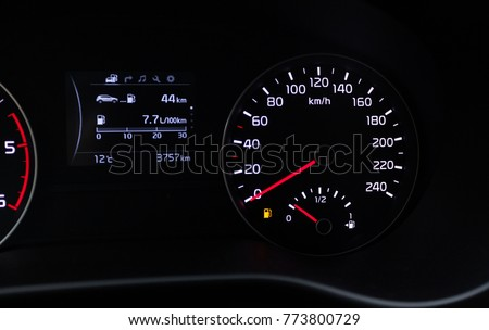 Fuel consumption theme. Empty tank indicator on car dashboard.