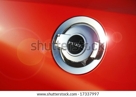 Fuel door icon on side of a custom muscle car - stock photo