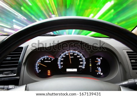 Fuel Economy on a vehicle speedometer with a red needle racing past numbers 90 km/h and engine runing 2500 RPM as the automobile achieves an improved efficiency rating as mandated by the government - stock photo