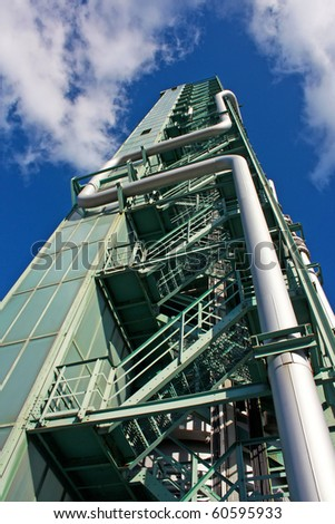 Fuel gas burning tower - stock photo
