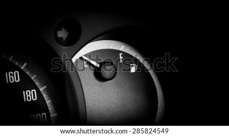 Fuel gauge dash board close up in car. - stock photo