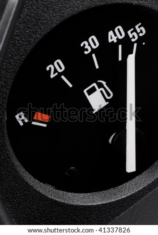 Fuel gauge in a car with position at full tank. Identifiable information are liters, reserve-mark and the pictogram of a petrol pump. - stock photo