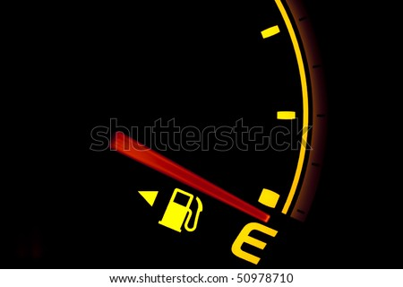 Fuel gauge showing and empty tank - stock photo