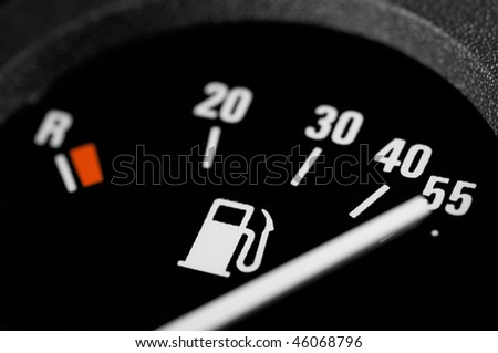 Fuel indicator of a car - stock photo