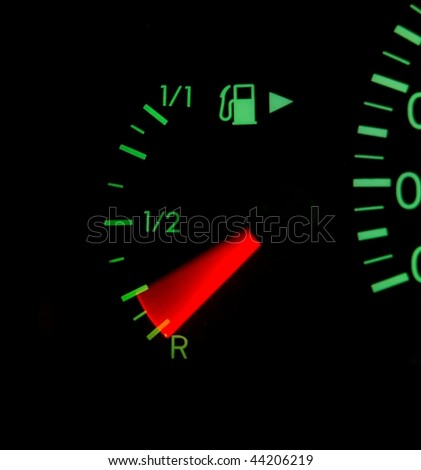 Fuel indicator of a car with motion blur - stock photo