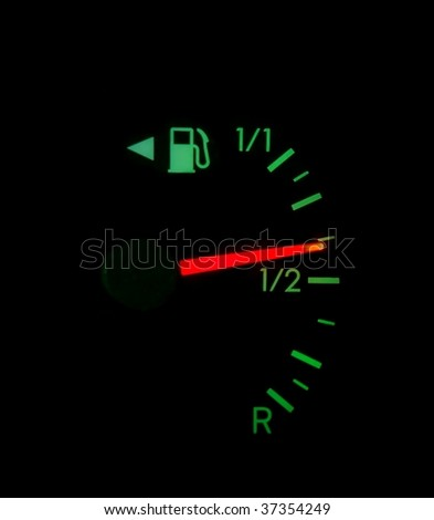 Fuel indicator showing tank is about half filled, mileage - stock photo