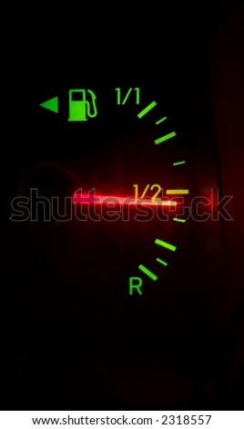 Fuel meter showing half - stock photo