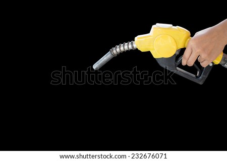 Fuel nozzle add fuel in car at gas station  - stock photo