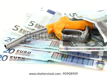 fuel nozzle and euro notes on a white background - stock photo