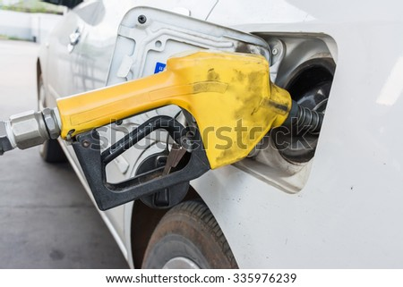 Fuel nozzle and white car