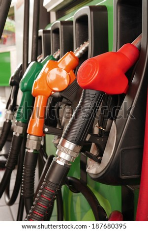 fuel nozzle at gas station - stock photo