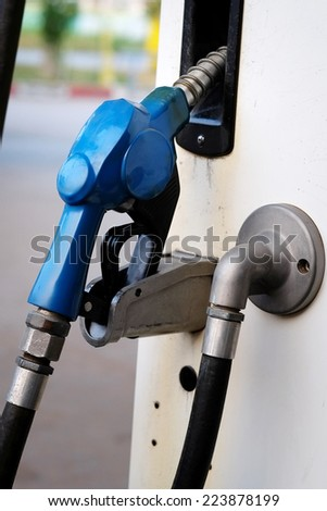 fuel nozzle at oil station